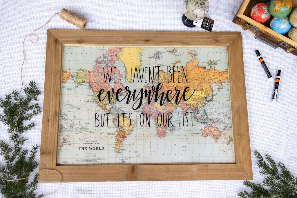 framed map with the wording lettered on it saying we haven't been everywhere but it's on our list