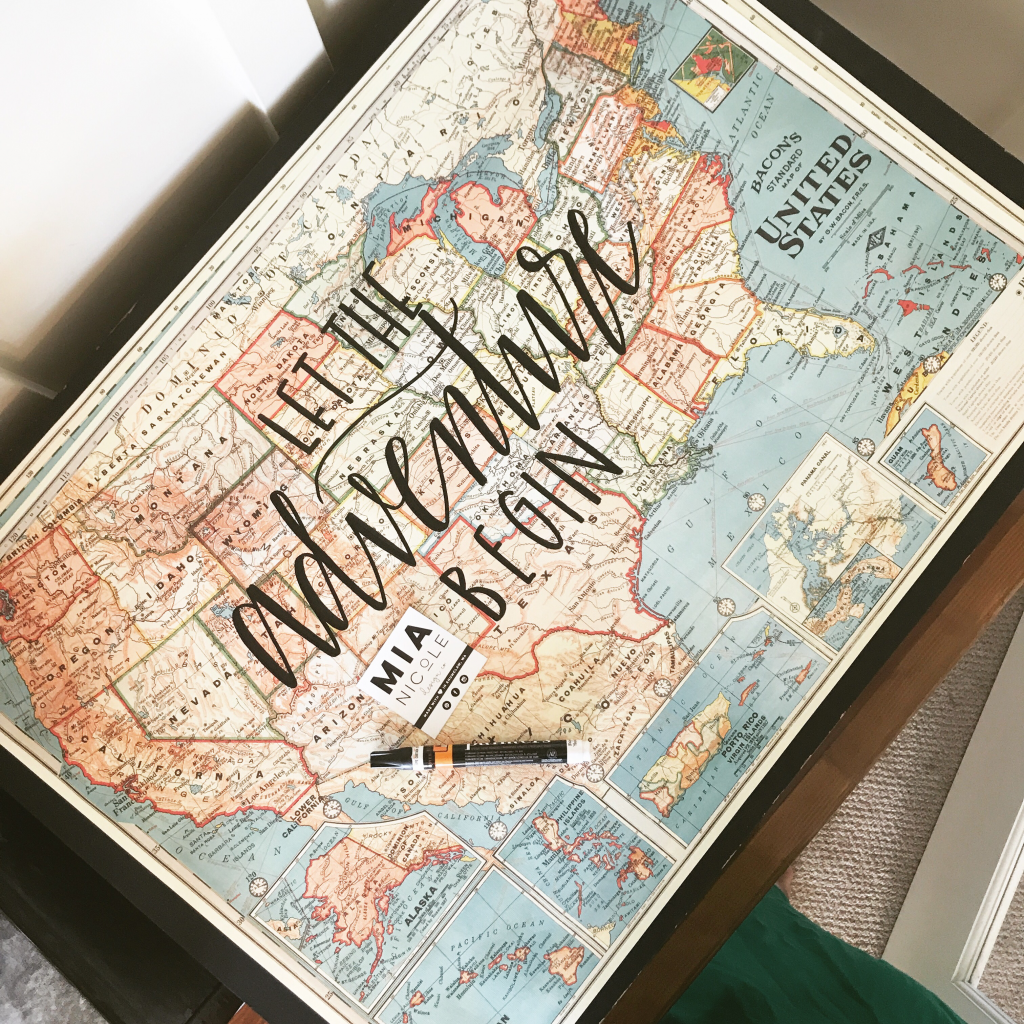 Let the Adventure begin quote hand lettered onto a United States map